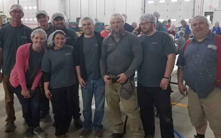 Grand Forks Team Members Help Feed My Starving Children Pack 4K Meals